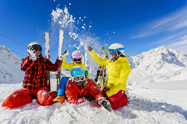 Ski, winter fun – skiers enjoying ski vacation